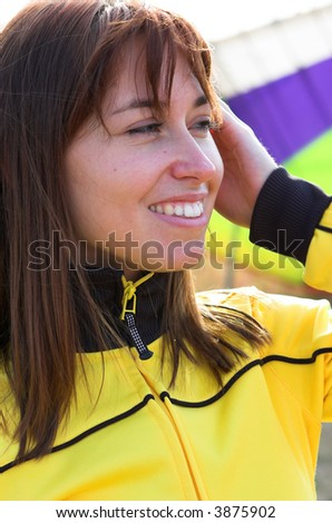 Smile woman portrait  in yellow