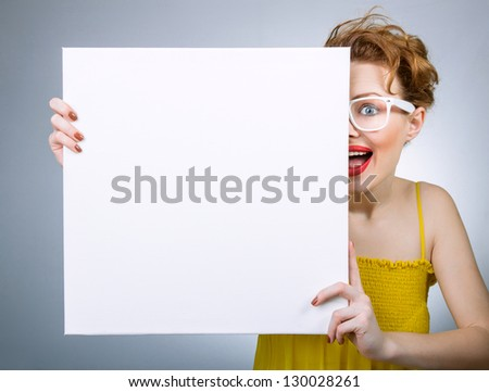 Smile woman with blank white board or panel - stock photo