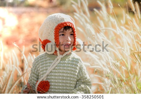smile young boy on field of grass flower - stock photo