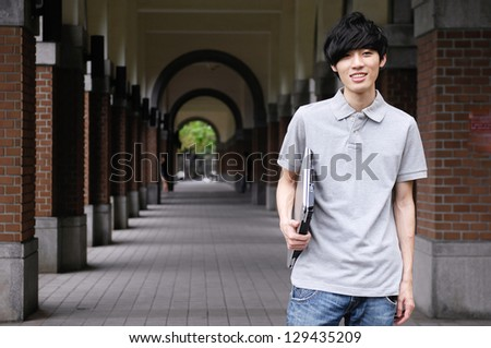 Smile young men with laptop at college - stock photo