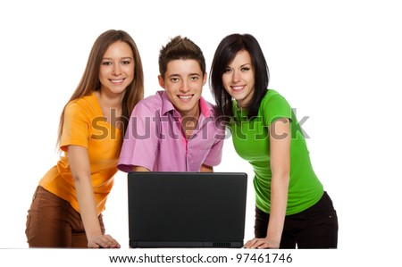 Smile young people looking laptop screen, communicating, three students at the desk using working on laptop, isolated over white background - stock photo