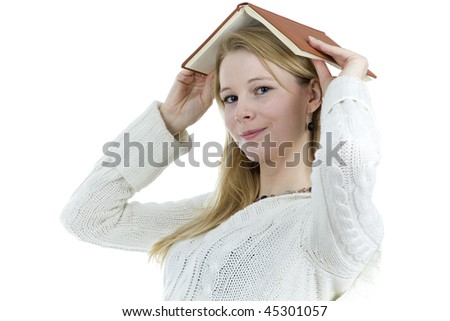 smile young woman from book on head - stock photo