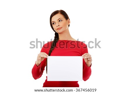 Smile young woman holding blank white banner