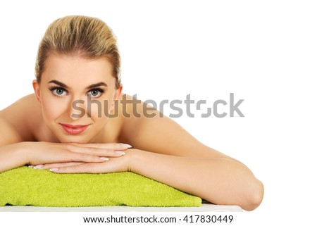 Smile young woman relaxing in spa - stock photo
