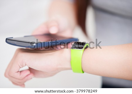 smile young woman use smart watch and smart phone, healthy lifestyle concept, asian beauty - stock photo
