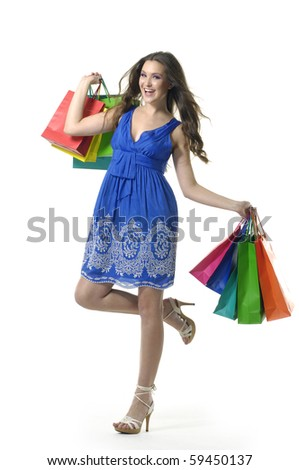 Smile young woman with colorful shopping bags in her hand - stock photo