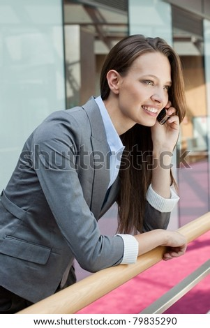 Smiled business woman with cell