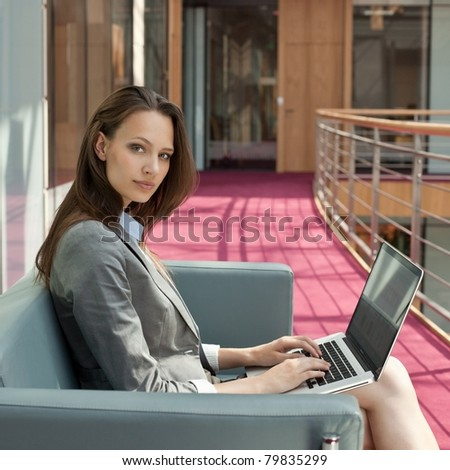 Smiled business woman with laptop