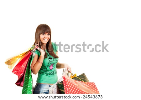 Smiled shopping girl holding lot of shopping bags