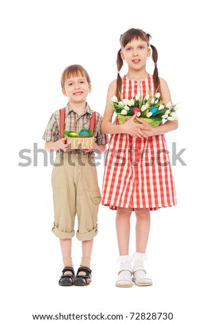 smiley boy and girl with easter gifts. isolated on white - stock photo