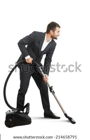 smiley businessman doing vacuum cleaning over white background