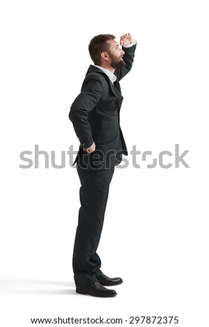 smiley businessman holding his hand near brow and looking up. isolated on white background - stock photo
