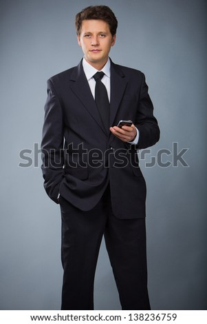 Smiley businessman in white helmet with arms crossed - stock photo