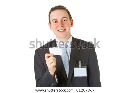 Smiley businessman showing business card over white background