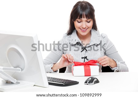 smiley businesswoman making christmas gift - stock photo
