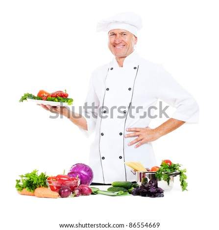 smiley chef holding plate with fresh vegetables. isolated on white background - stock photo