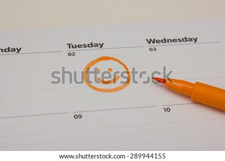 Smiley drawing on calender - stock photo
