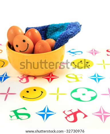 Smiley egg on a cheerful table spread - stock photo