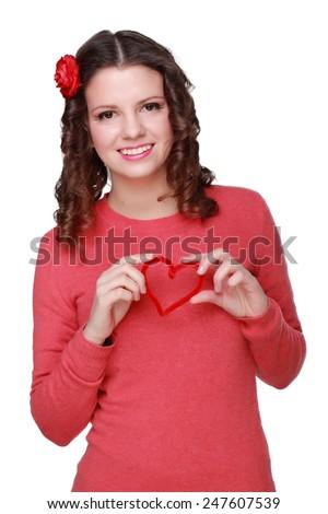 Smiley face of brunette curly hair european girl holding love heart symbol  - stock photo