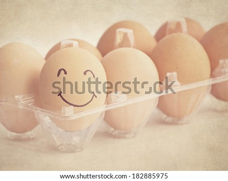 smiley face on egg in vintage style - stock photo