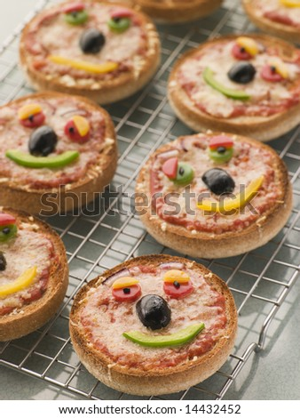 Smiley Faced Pizza Muffins - stock photo