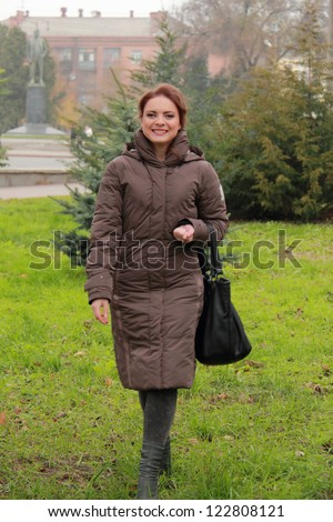 Smiley female woman outdoor at autumn time