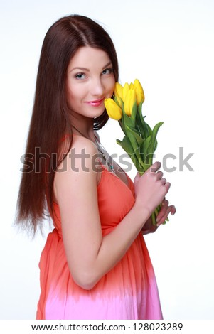 Smiley girl holding a bouquet of fresh flowers on Holiday