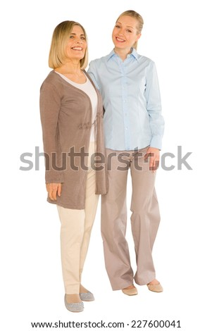 smiley grandmother and young mother standing on white background - stock photo