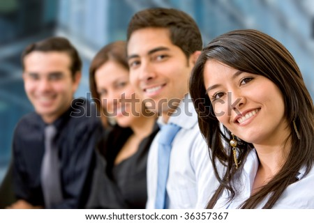 Smiley group of business people at an office - stock photo