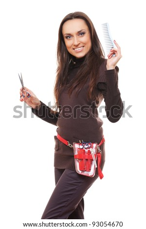 smiley hairdresser with tools against white background - stock photo