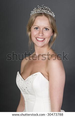 Smiley Happy Bride on Grey Background - stock photo