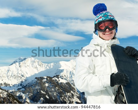 smiley happy sportsman with snowboard at winter mountain outdoor - stock photo
