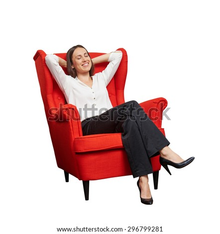 smiley happy woman with closed eyes sitting on red chair and dreaming. isolated on white background