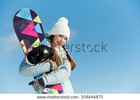smiley happy youbg sportswoman with snowboard at winter outdoor - stock photo