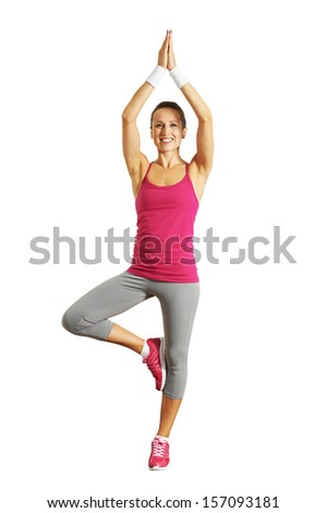 smiley healthy young woman doing yoga. isolated on white background - stock photo