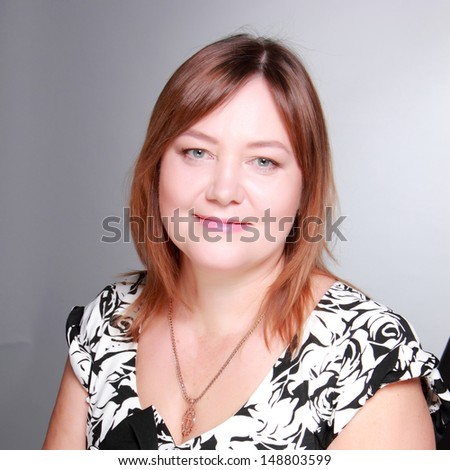 Smiley mid adult pretty woman on Beauty and Fashion theme - stock photo