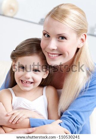 Smiley mummy with her daughter - stock photo