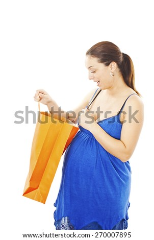 Smiley pregnant woman holding shopping bag. Isolated on white background  - stock photo