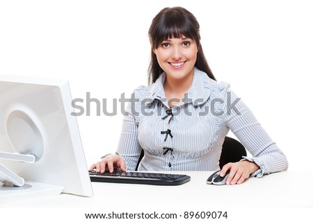 smiley secretary sitting on workplace and smiling - stock photo