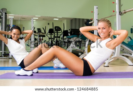 smiley woman doing exercises at the fitness club
