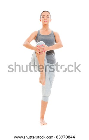 smiley woman doing stretching exercise. isolated on white background - stock photo