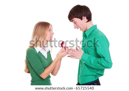 smiley woman giving ring to man. isolated on white - stock photo