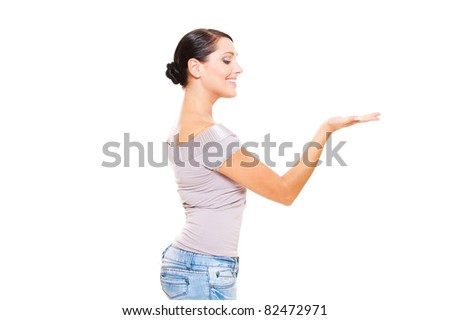 smiley woman holding something on her palm. isolated on white background - stock photo