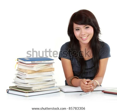smiley woman learning with a stack of book