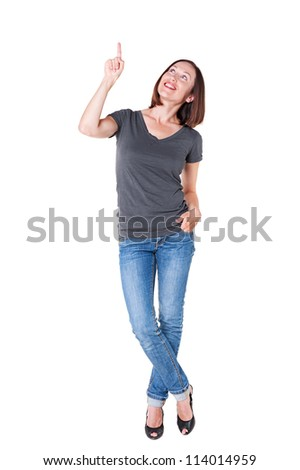 smiley woman pointing and looking up. full length shot over white background - stock photo