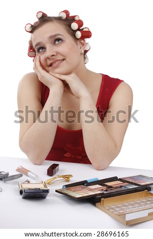 Smiley woman with hair-rollers on a white background. - stock photo