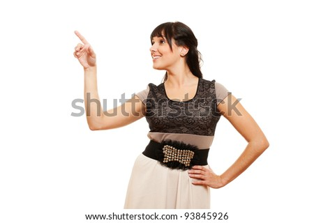 smiley young woman pointing at something. isolated on white background - stock photo