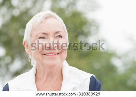 Smililing senior woman with grey hair - stock photo