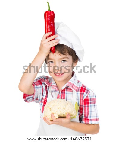 smilimg boy with red pepper and cauliflower isolated on a white background - stock photo