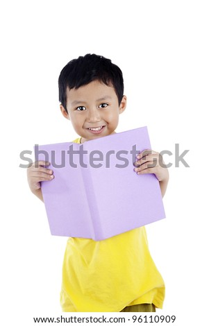 Smiling adorable boy reading a book, shot in studio isolated on white - stock photo